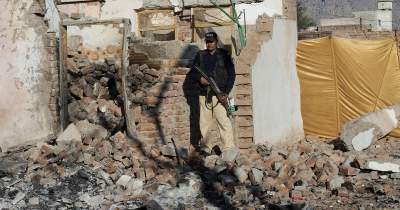 Photo: Policeman guarding newly erected demolished structure near Hindu temple